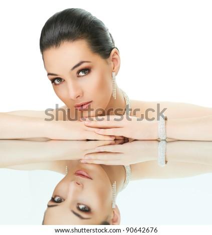 portrait of beautiful woman with jewelry - stock photo