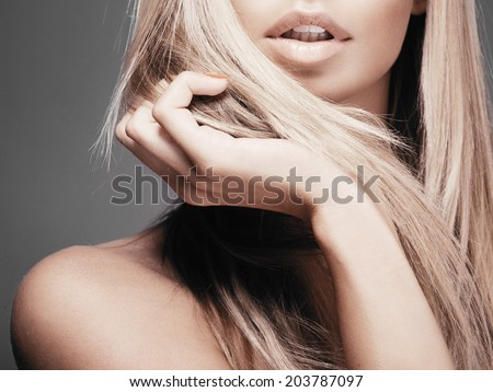 Portrait of beautiful woman with long blond hair - stock photo