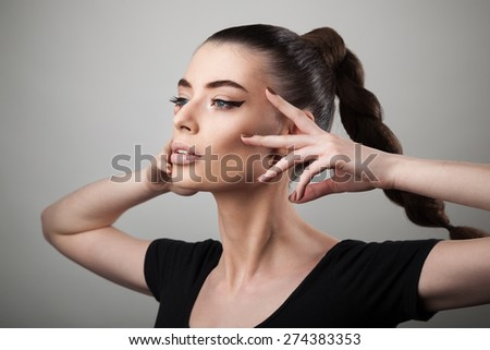 Portrait of beautiful woman with perfect skin and make-up - stock photo