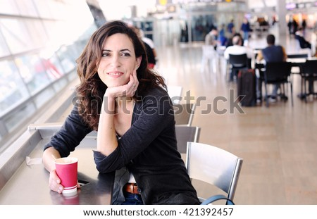 Portrait of beautiful 40 years old woman holding cup of coffee - stock photo