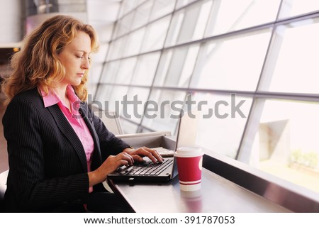 Portrait of beautiful 35 years old woman with laptop - stock photo