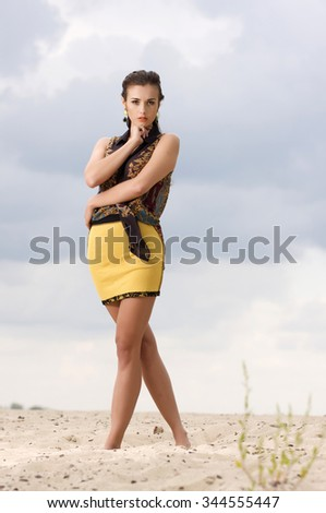 Portrait of beautiful young adult attractive sexy and sensuality pretty brunette woman posing on background blue sky. Outdoor shot - stock photo