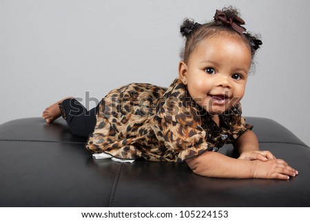 Portrait of beautiful young African American 6 month old infant baby - stock photo
