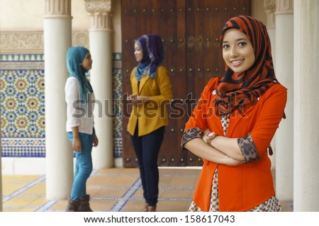 Portrait of beautiful young Asian student - stock photo