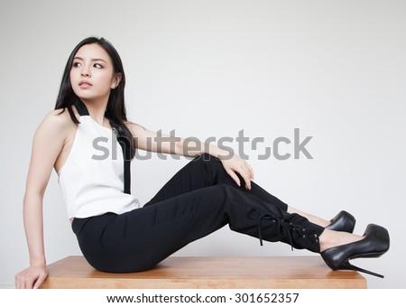 Portrait of beautiful young Asian woman - stock photo