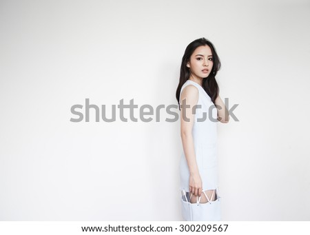 Portrait of beautiful young Asian woman in blue dress - stock photo