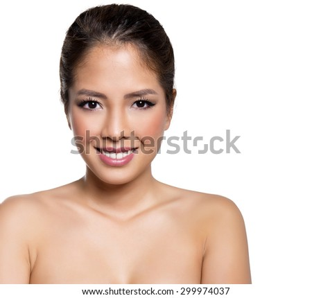 portrait of beautiful young asian woman with clear skin isolated on white - stock photo