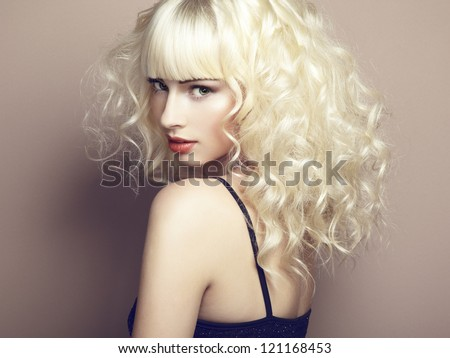 Portrait of beautiful young blonde girl. Fashion photo - stock photo