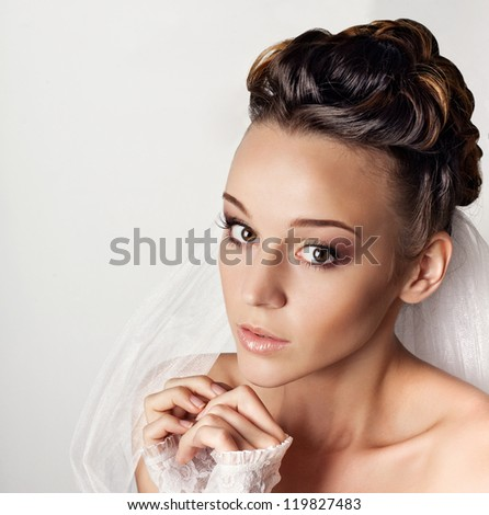 Portrait of beautiful young bride on white background - stock photo