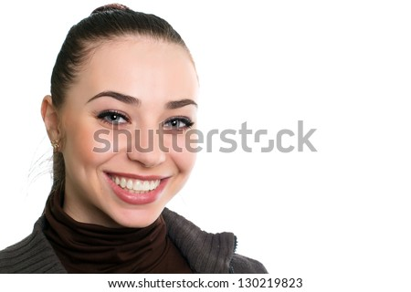 Portrait of beautiful young brunette with charming smile. Isolated on white - stock photo