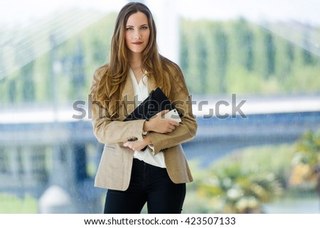 Portrait of beautiful young businesswoman looking at camera. - stock photo