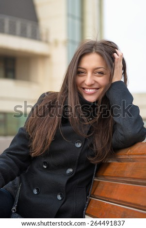 Portrait of beautiful young cheerful woman. - stock photo