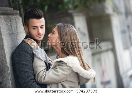 Portrait of beautiful young couple outside. Couple in love outdoor on street. - stock photo
