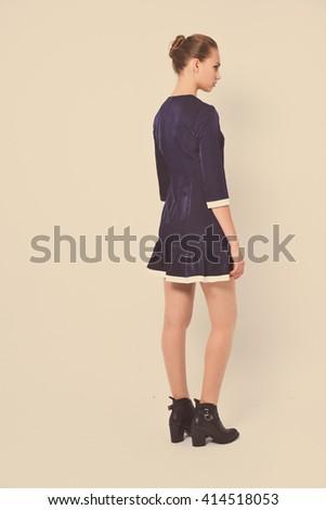 portrait of beautiful young fashion woman posing on retro background  - stock photo