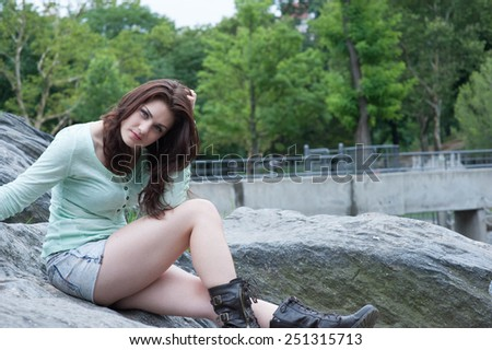 Portrait of beautiful young female in the park - stock photo