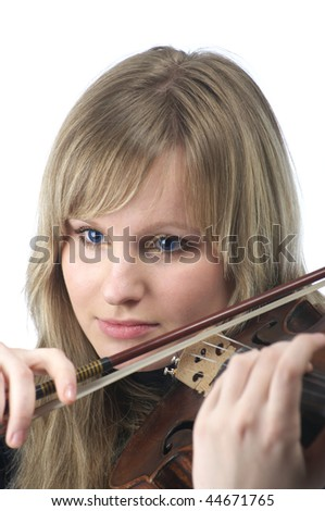 Portrait of beautiful young female violinist playing violin over white background - stock photo