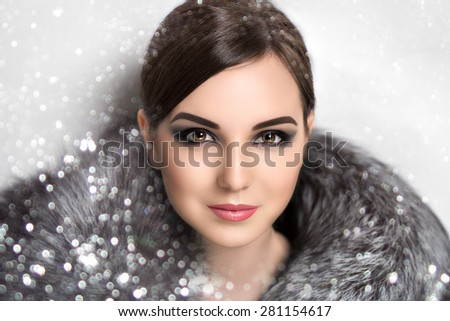 Portrait of beautiful young girl, lady, woman, model, actress, star, celebrity. Winter, New Year, Christmas, luxury, wealth. Elegant look, spectacular makeup, smoky eyes, ideal eyebrows,chic hairstyle - stock photo