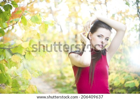 Portrait of beautiful young girl on nature. - stock photo