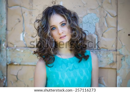 Portrait of beautiful young girl on the vintage background - stock photo