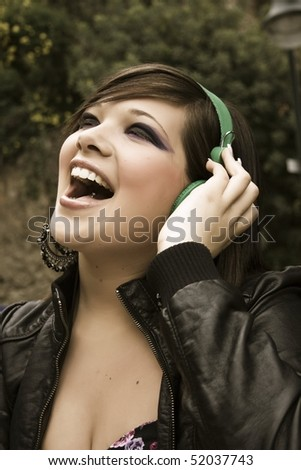 portrait of beautiful young girl singing with emotion - stock photo