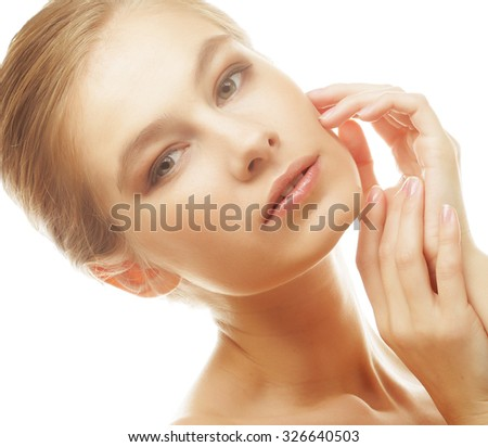 Portrait of beautiful young girl with clean skin on pretty face - stock photo