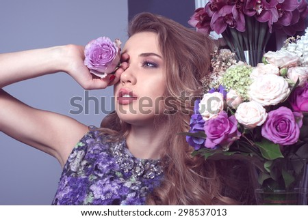 portrait of beautiful young girl with violet rose in her hand am - stock photo