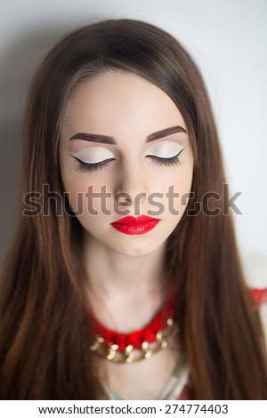 Portrait of beautiful young girl, woman, lady, model. Flawless makeup, perfect shape of  eyebrows, long eyelashes, best bright red lipstick. Image can be used for advertising of new cosmetic products - stock photo