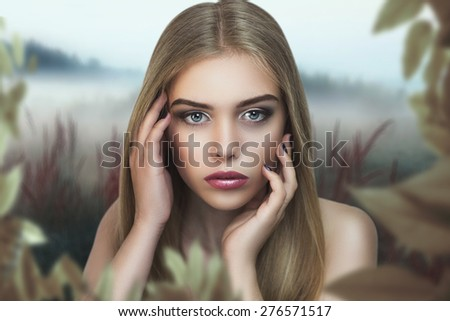 Portrait of beautiful young girl, woman, lady, model, forest nymph, Mavka, mythical creature, fairy tale character. Light background, nature, leaves. Expressive makeup, perfect face, eyes, pink, lips. - stock photo