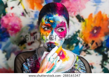 Portrait of beautiful young girl, woman, lady,model,painting, canvas,art, painting,expressionism. Bright creative makeup, expressive eyes, paint, colorful, yellow, blue pink, white flowers. hand berry - stock photo