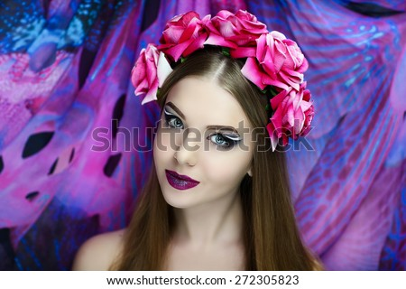 Portrait of beautiful young girl, woman, model, sorceress, fairytale, magic, illusion. Perfect, creative makeup, light skin, bright, expressive eyes, purple lips, charming smile. Chic fashion look.  - stock photo