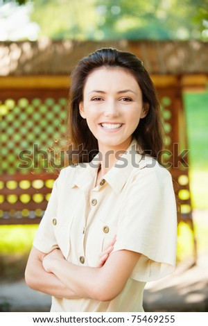 Portrait of beautiful young girls against a wooden lattice - stock photo
