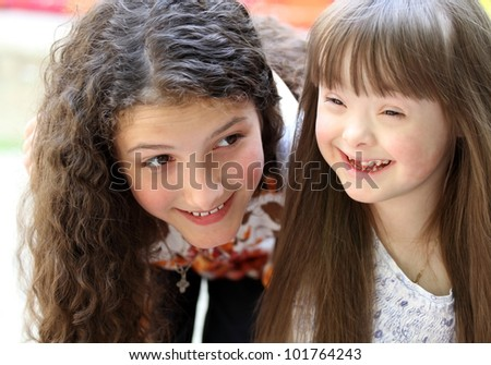 Portrait of beautiful young girls on the playground. - stock photo