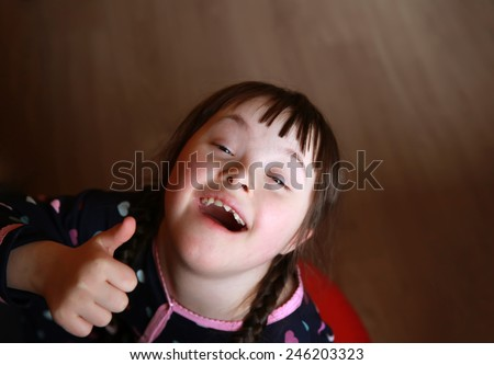 Portrait of beautiful young happy girl - stock photo