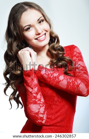 Portrait of beautiful young happy smiling woman with long curly hair - stock photo
