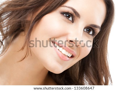Portrait of beautiful young happy smiling woman with long hair, isolated over white background - stock photo