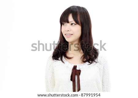 Portrait of beautiful young japanese smiling woman - stock photo