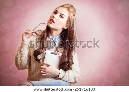 Portrait of beautiful young lady holding tablet pc computer and glasses - stock photo