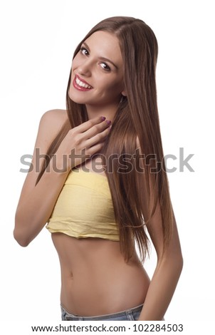 Portrait of beautiful young lady with long dark hair over white - stock photo