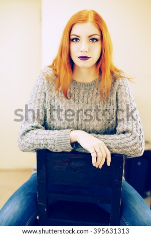 Portrait of beautiful young redheaded woman. Make up artist woman with bright makeup. Beauty concept - stock photo