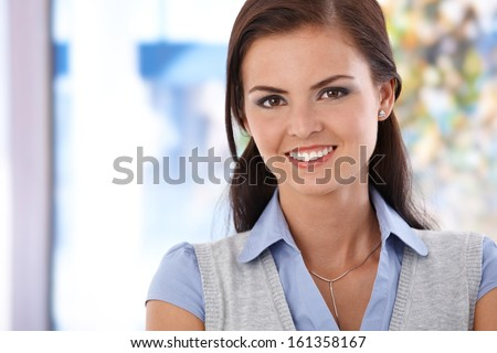 Portrait of beautiful young smiling woman. - stock photo