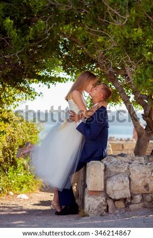 Portrait of beautiful young wedding couple - stock photo