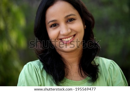 Portrait of beautiful young woman at outdoors - stock photo