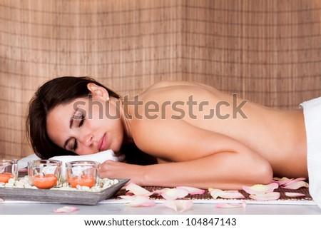 Portrait of beautiful young woman at spa salon - stock photo