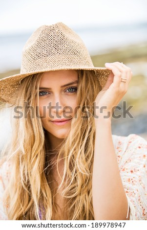 Portrait of Beautiful Young Woman at The Beach. Fashion Lifestyle Concept - stock photo
