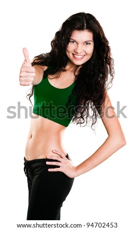 Portrait of beautiful young woman dressed in green sportswear posing isolated on white background - stock photo