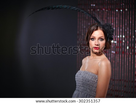 Portrait of beautiful young woman face. Isolated on dark background. - stock photo