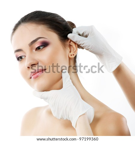 portrait of beautiful young woman face with beauty treatment ear plastic isolated - stock photo