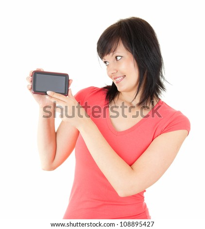 portrait of beautiful young woman holding smartphone, white background - stock photo