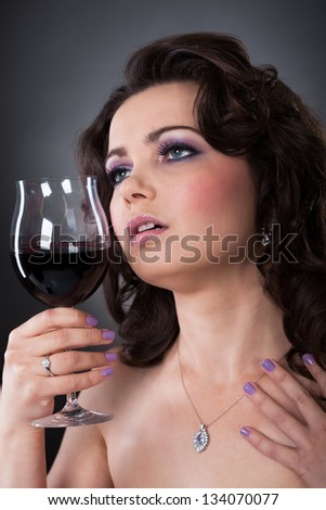 Portrait Of Beautiful Young Woman Holding Wine Glass - stock photo