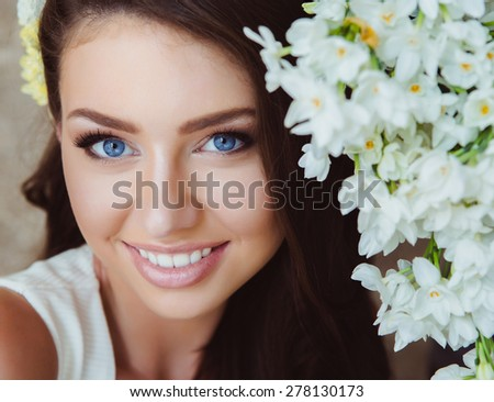 Portrait of Beautiful Young Woman in Flowers. Healthy Long Hair and Clear Skin. - stock photo
